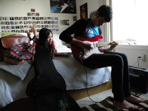 geena in a magazine; bryan on guitar.