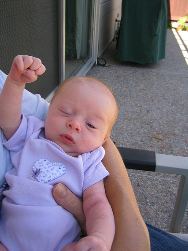 victory fist, baby = victory fist baby + a wink, for good measure.